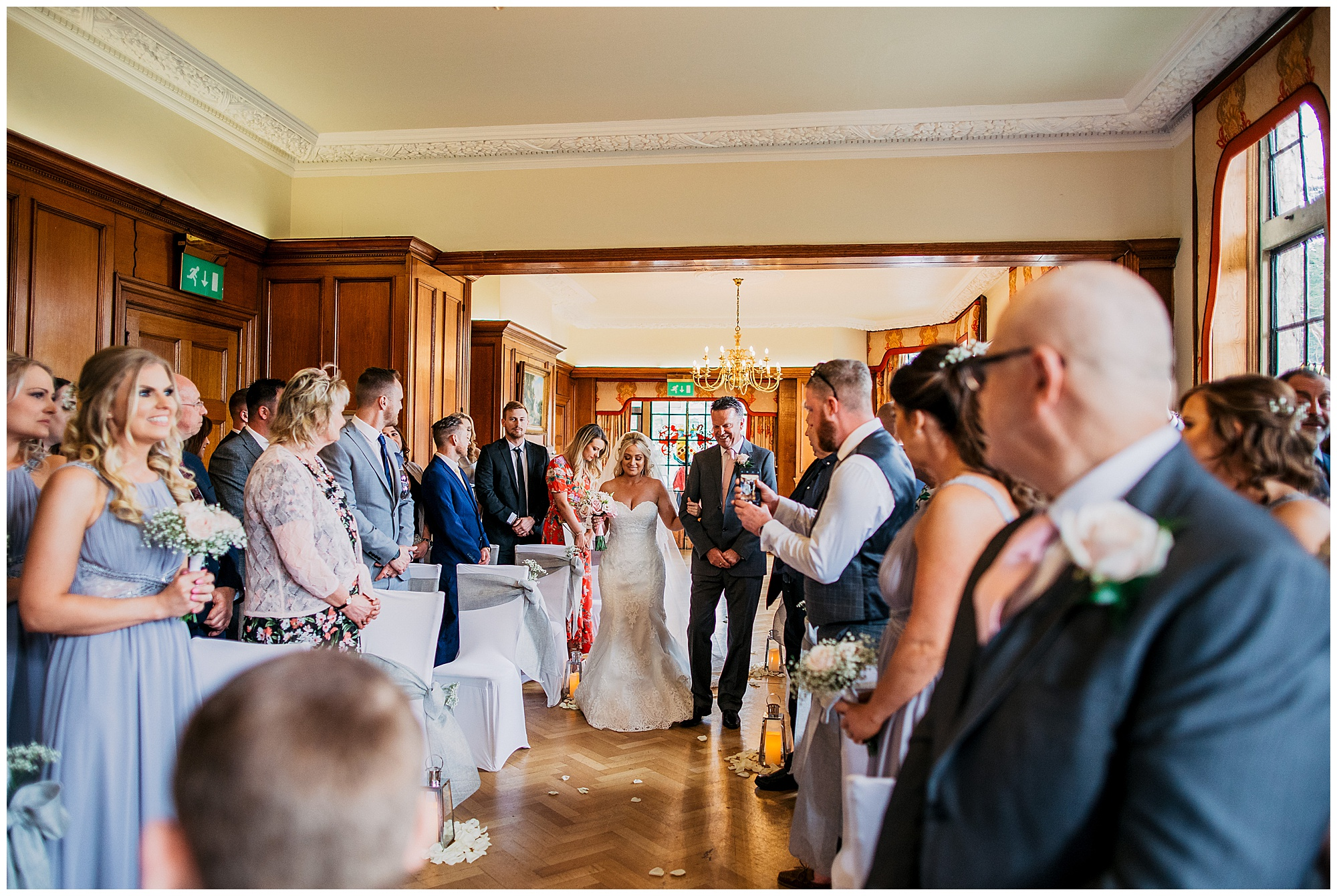 bride walking down the aisle at pennyhill park hotel and spa